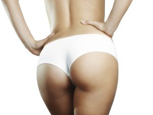 Perfect female buttock in white panties. Isolated on white